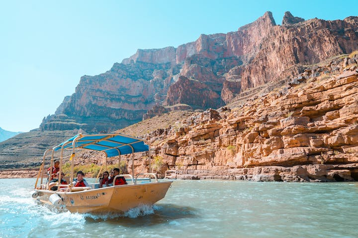 Boat with tourists going down the Grand Canyon river