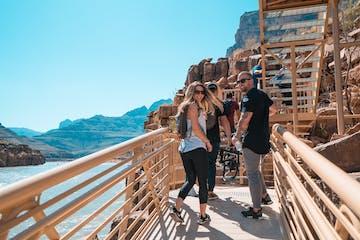 People walking across bridge over lake in Arizona