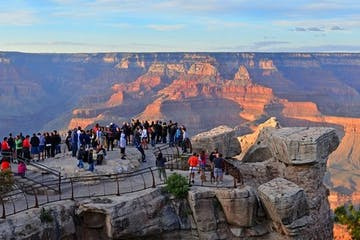 Large group of tourists at Grand Canyon overlook