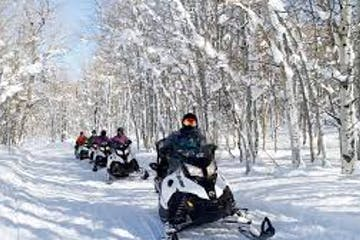 a group of people riding on the snow