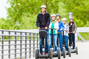 people riding on segways