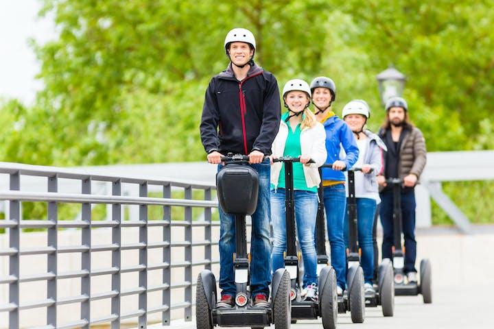 people riding on segways