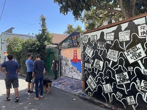 People viewing murals in the Mission