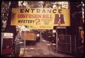 a sign at the entrance of Confusion Hill