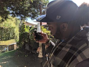 Man looking at a bong outdoors in The Emerald Triangle