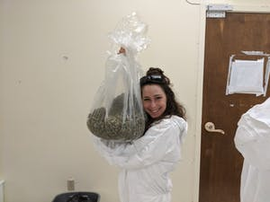 A woman holding an enormous bag of weed