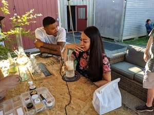 Couple at a dab bar at Kure Wellness Center in The Emerald Triangle