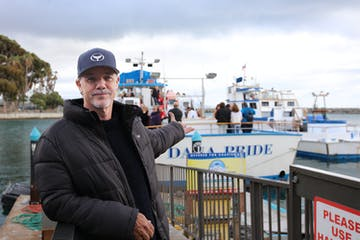 Robert Wyland standing next to a dock