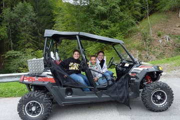 family on a 4x4 during a tour