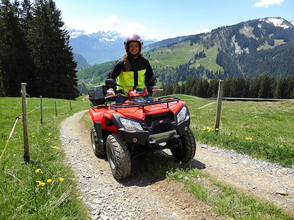 woman on a red quad in Switzerland