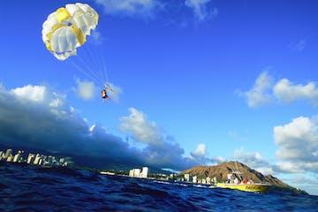 people parasailing in Honolulu, Hawaii