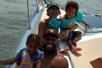 a family of four enjoying the boat