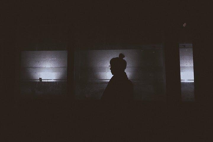 silhouette of a person in the dark