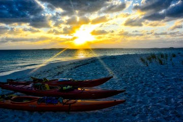 Kayaks sunset beach