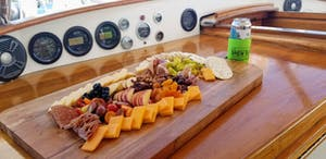 a tray of food on a wooden cutting board