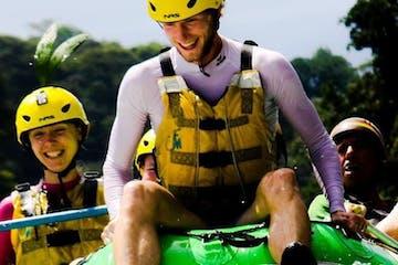 people having fun rafting down a river