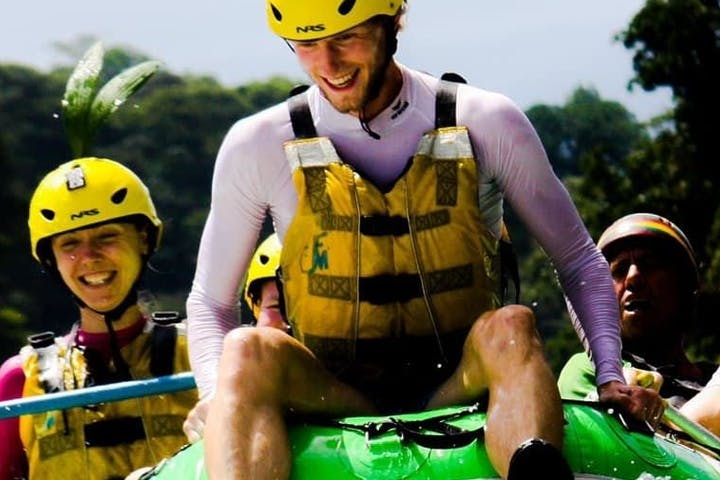 people having fun rafting down a river