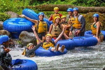 group of people rafting on a river