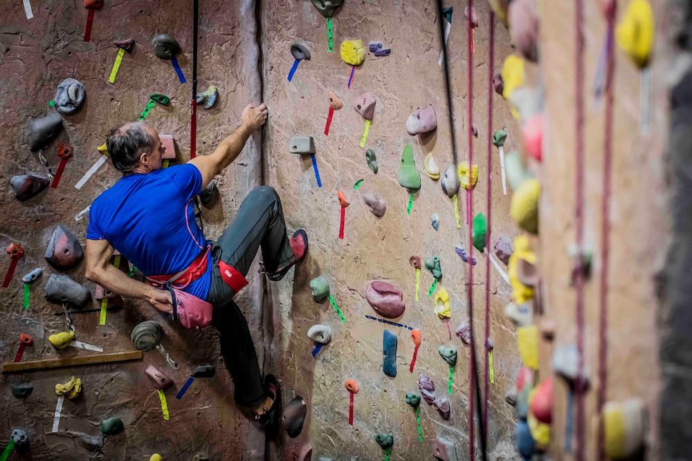 Man climbing at an indoor gym