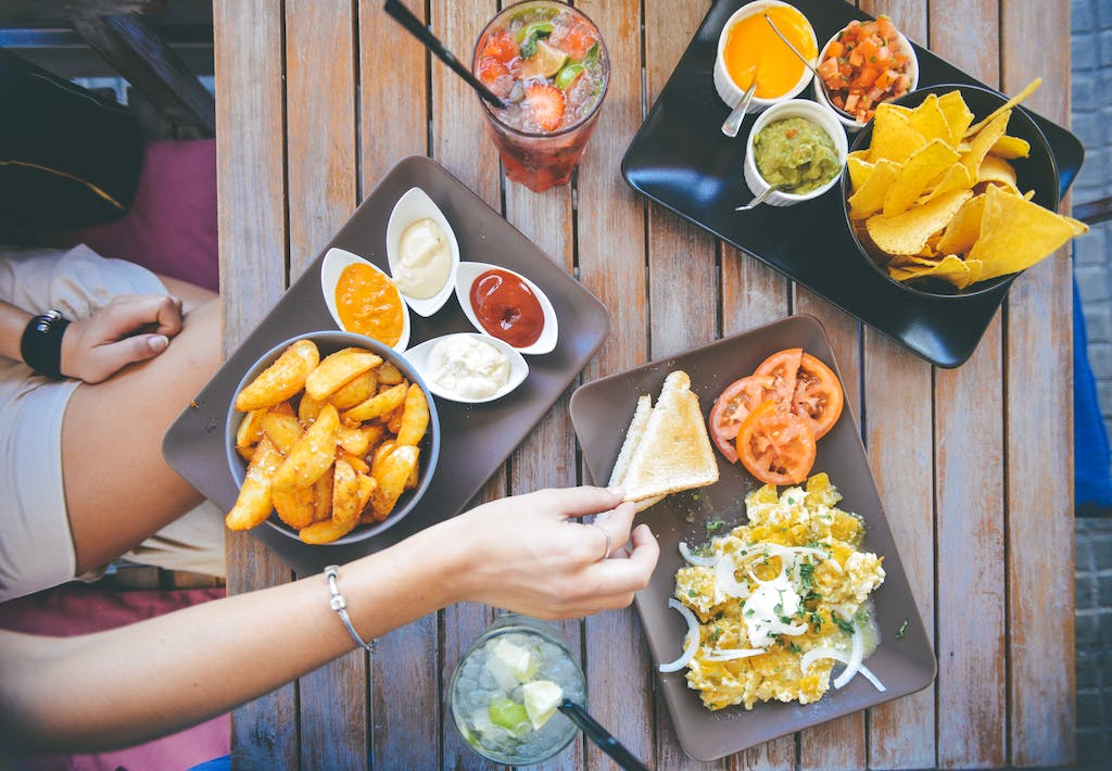 top down view of apps and drinks at a restaurant