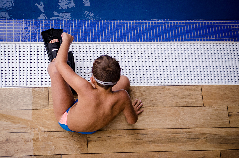 Whistler Indoor pool - boy sitting on the edge