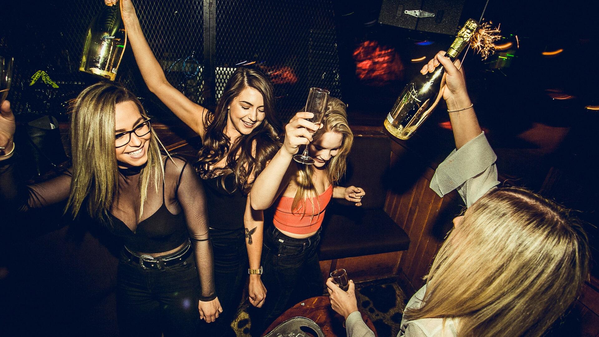Women party at a bar