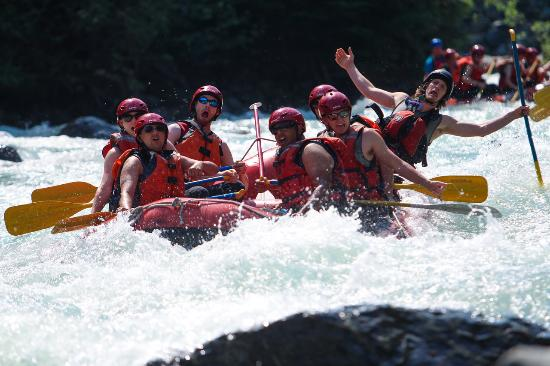 People in white water raft around whistler