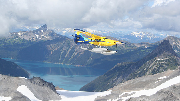 Float plane over glacier and mountains