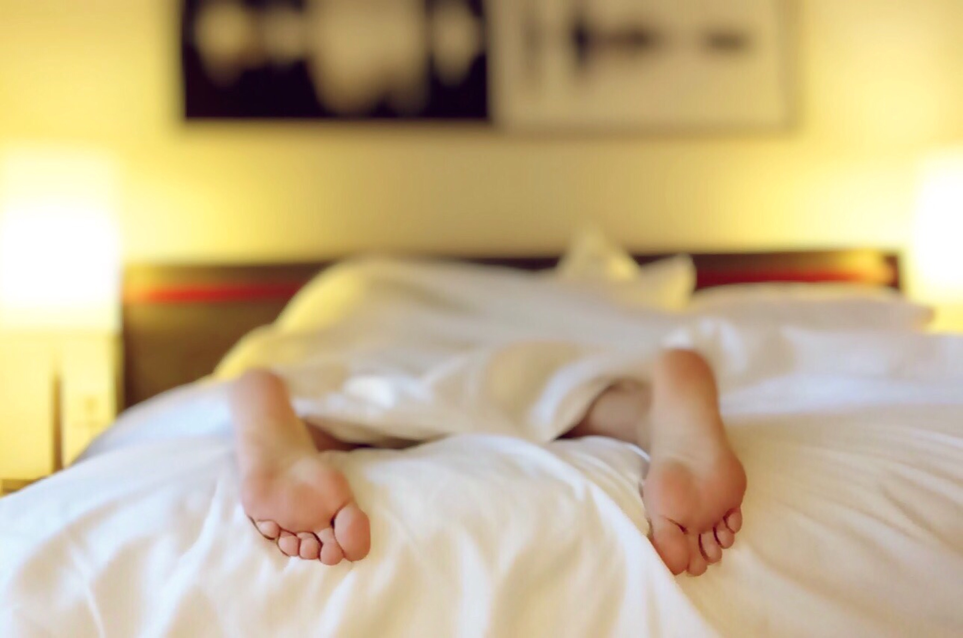 Feet at the end of the bed