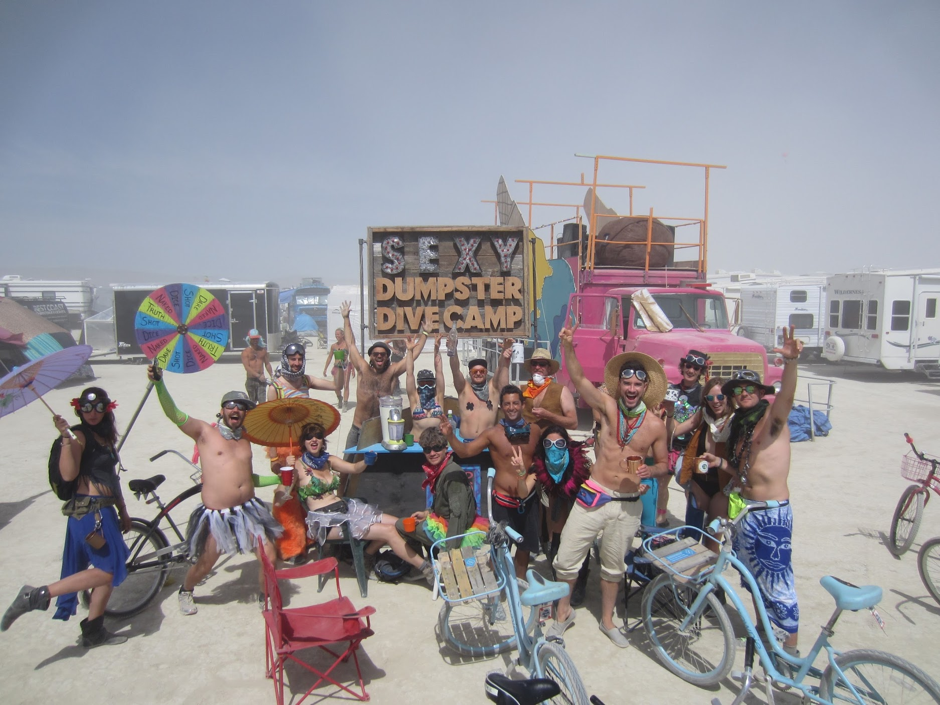 A wild crowd in front of a bar are burning man