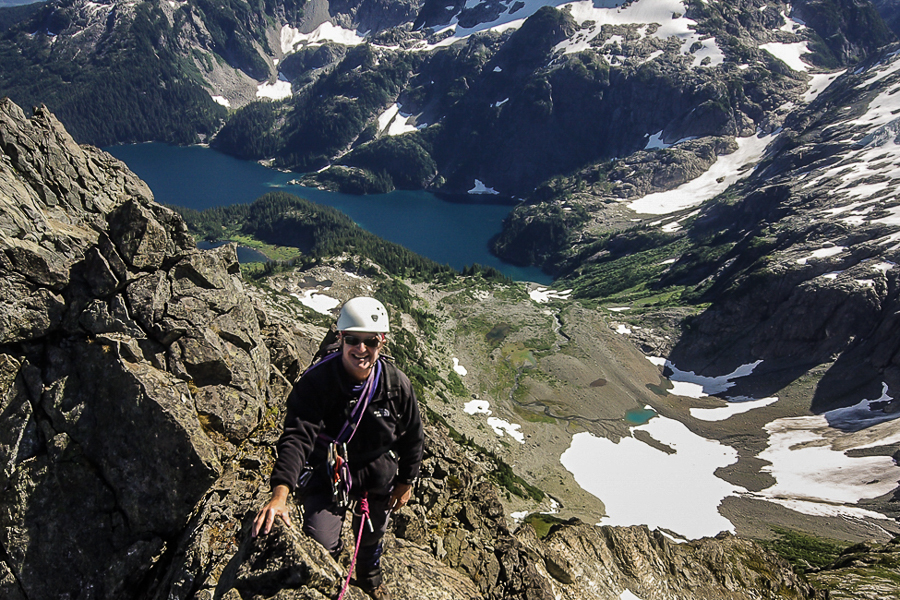Climber on the edge of a mountain
