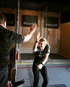 High five after winning axe throwing
