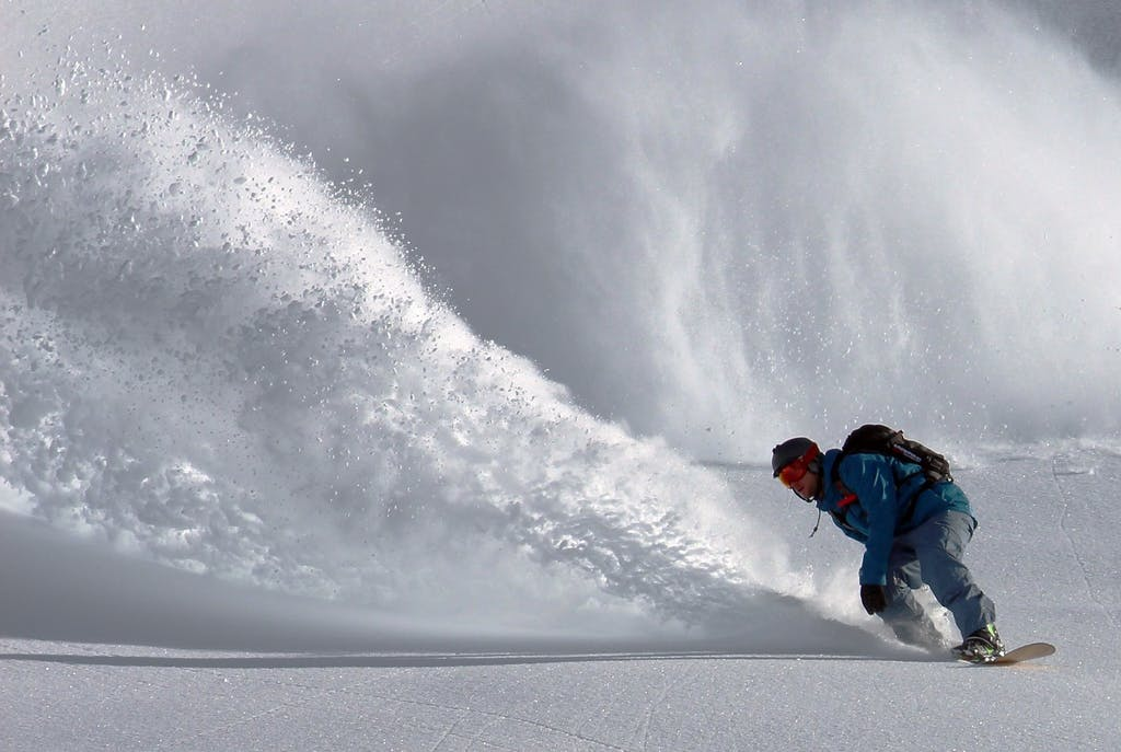 Snowboarder on a wall of snow