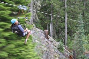 A person speeding down a zipline