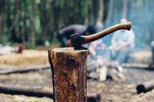 Axe in log around a camp fire