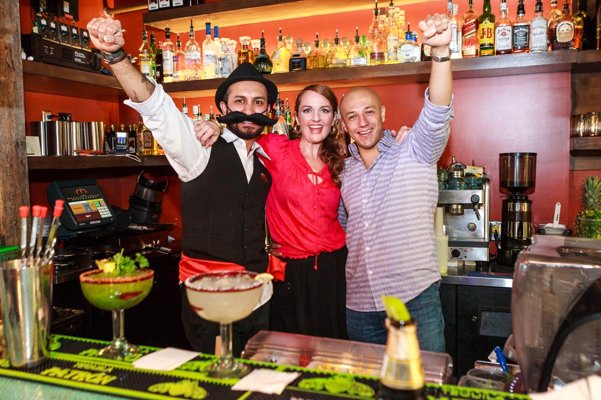 Three people behind the bar at the Mexican Corner Whistler