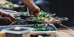 A chef preparing a plant-based dish