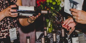 Woman pouring wine at an event