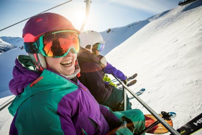 Two women on a ski lift in Whistler