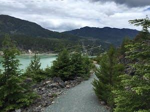 Gravel valley trail next to lake