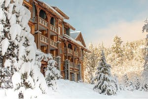 a hotel in Whistler covered in snow