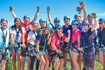 A group of zipliners posing for a picture