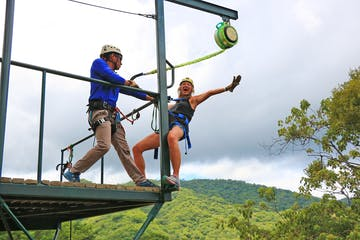 A woman getting ready to jump into her zipline adventure
