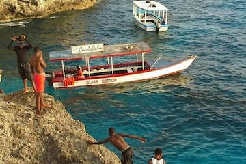 boats and people on a cliff Jamaica coast
