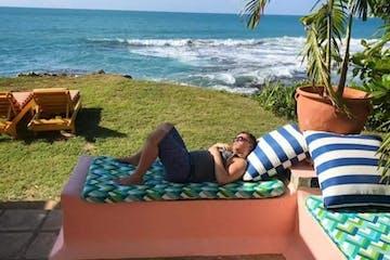 man sleeping on the Jamaica coast