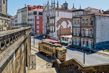 A tramway in Porto with a church