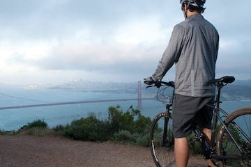 riding over a hill overlooking the golden gate bridge