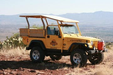 yellow jeep against the sedona red rock landscape