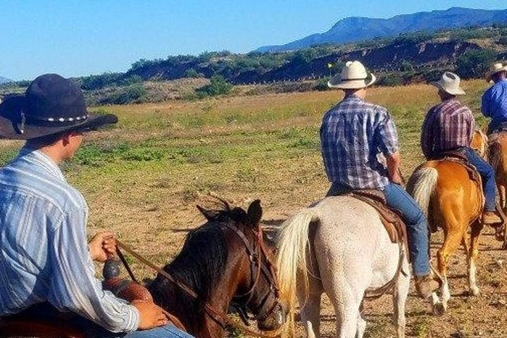 people riding horses in the landscape around sedona az