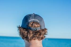 a man wearing a blue hat